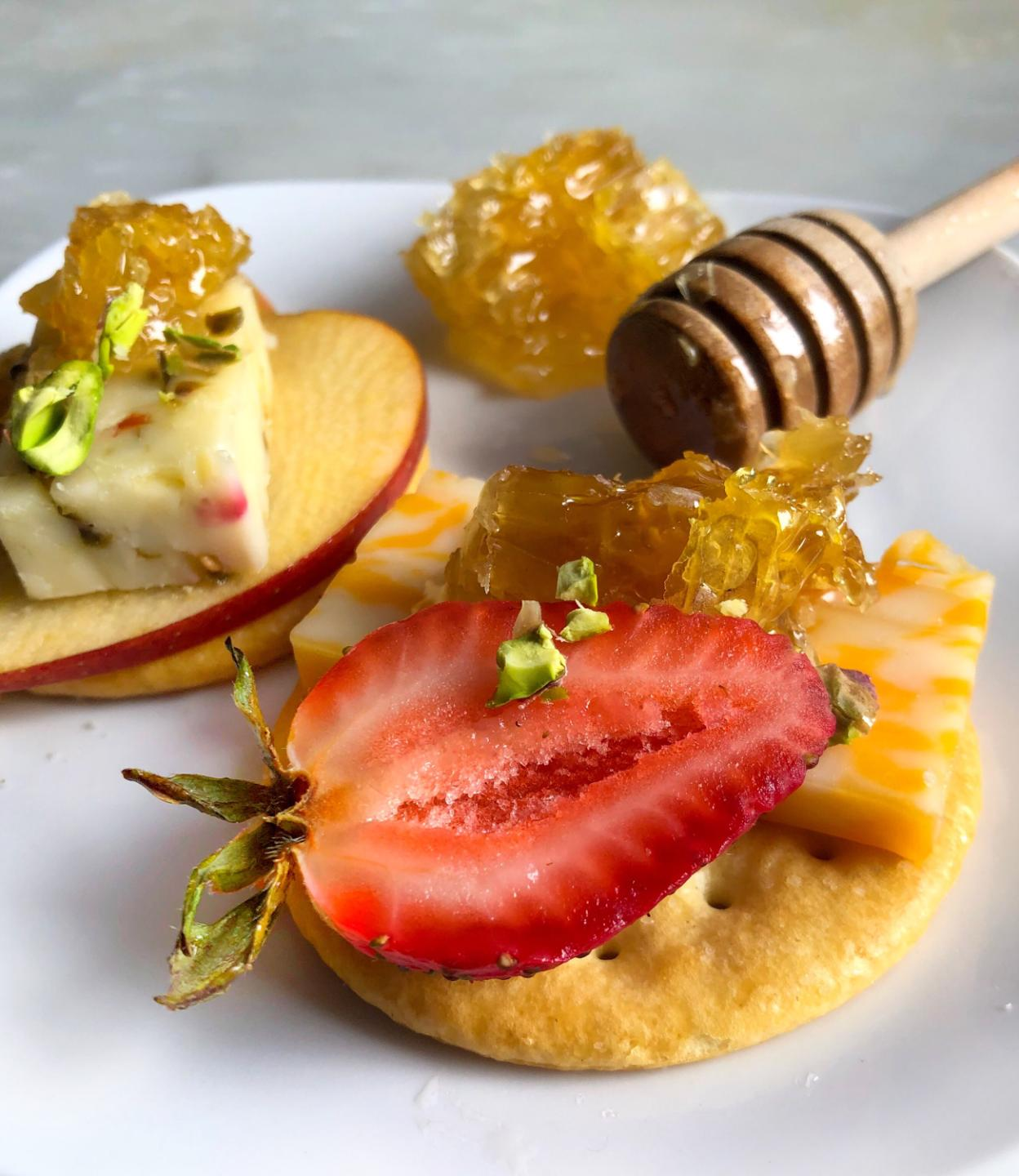 Wild Garden Honey Comb on Crackers with strawberry and cheese